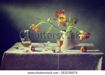 Still life with tulips and a glass of wine - stock photo