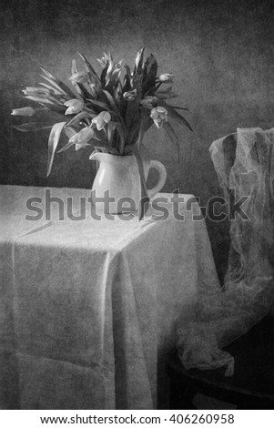 Still life with tulips and drapery (textured for artistic effect) - stock photo
