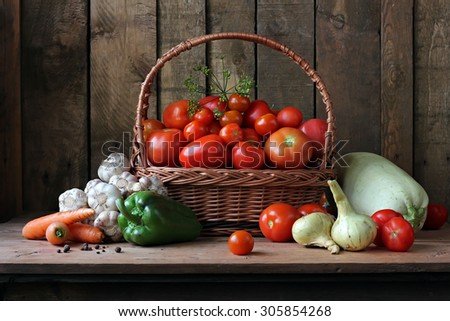 Still life with vegetables: vegetable marrow, tomato, pepper, fennel, carrots, onions, garlic, pumpkin. Vegetables in a basket. Ingredients for preparation of marrow caviar. - stock photo