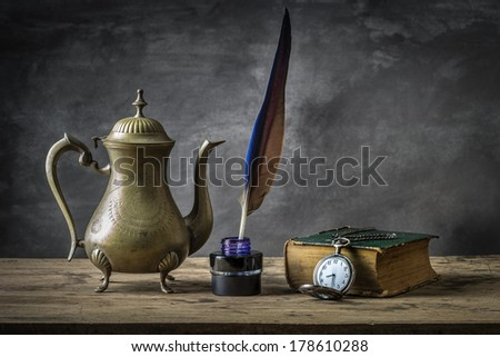 Still life with vintage antique pocket watch, brass tea pot and  grunge book - stock photo