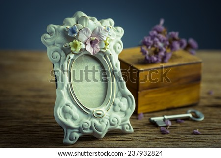 Still life with vintage classic photo frame and key - stock photo