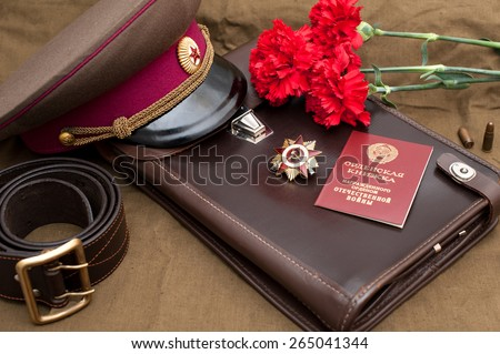 Still life with vintage objects dedicated to Victory Day. Order of the patriotic war 1st class. - stock photo