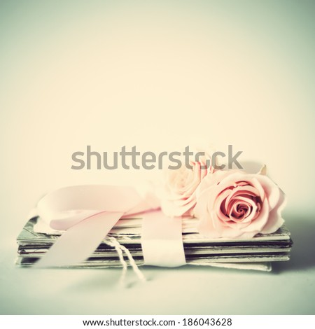 Still life with vintage pink roses - stock photo