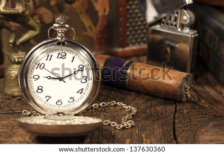 still life with vintage pocket watch