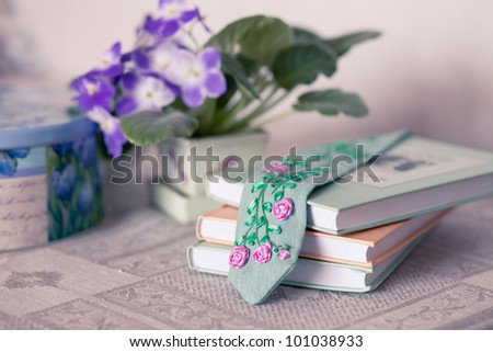 Still life with violets, books and a bookmark