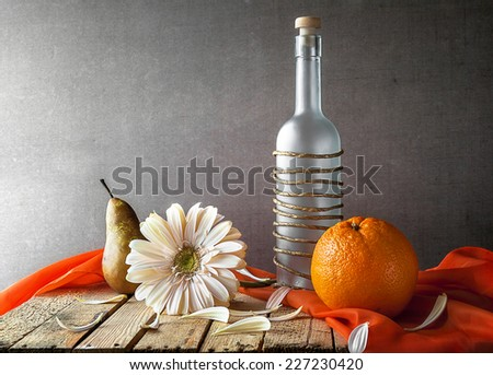 Still life with white gerbera and fruits - stock photo