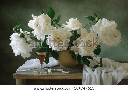 Still life with white peonies and a glass of wine