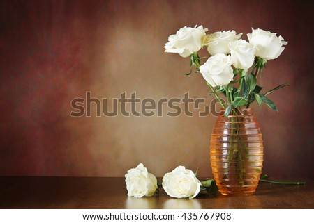 Still life with white roses in the vase on a wooden surface against brown background - stock photo
