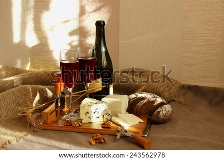 Still-life with wine and cheese with mold