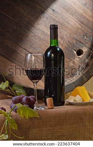 Still life with wine barrel, bread and cheese