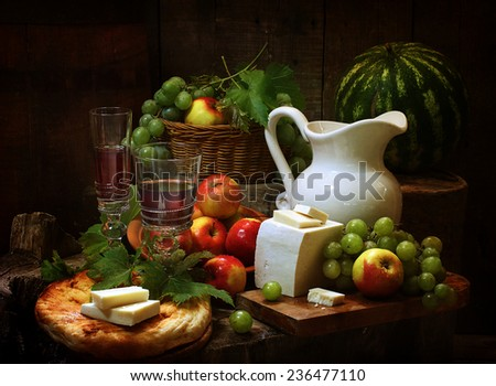 Still-life with wine both fresh fruit and cheese and a water-melon - stock photo
