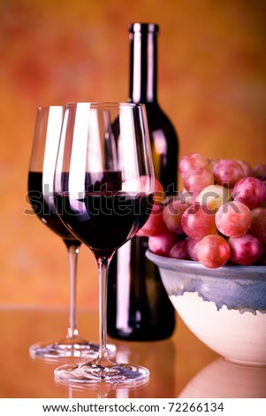 still life with wine bottle and grapes