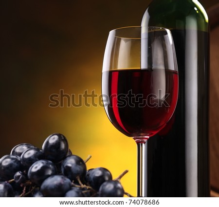 Still life with wine bottle, glass and grapes - stock photo