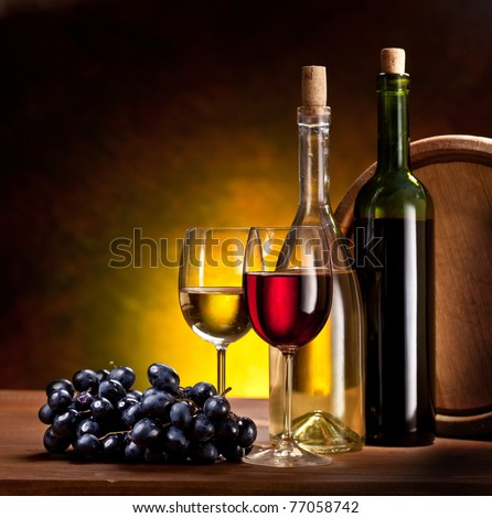 Still life with wine bottles, glasses and oak barrels. - stock photo