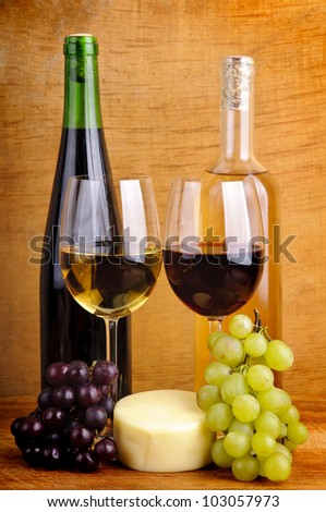 still life with wine, cheese and grapes