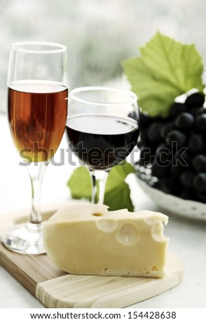 still life with  wine glass, cheese and grapes - stock photo