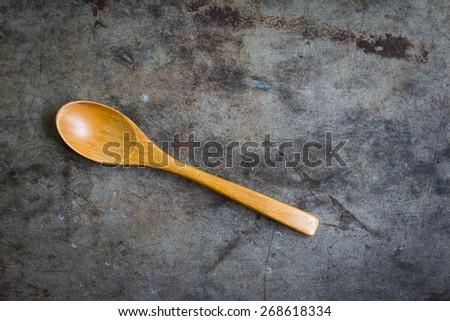 still life with wooden spoon on table grunge background, top view - stock photo
