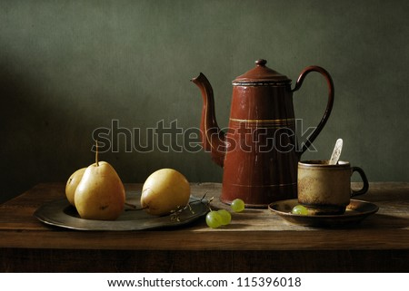 Still life with yellow pears and an old coffee pot - stock photo