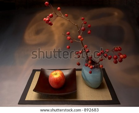 Still life with yellow-red apple and vases - stock photo