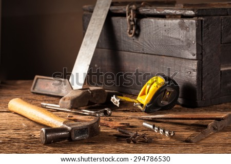 Still life Work tools chest on a wooden table - stock photo