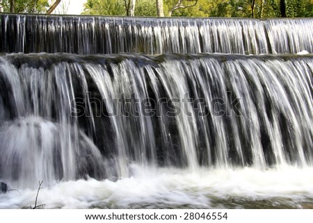 Still shot of a waterfall and path in a nature reserve - stock photo