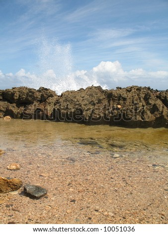 Still water in a tidal pool in Aruba - stock photo