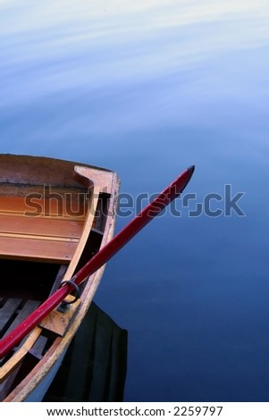 Still water rowboat - stock photo