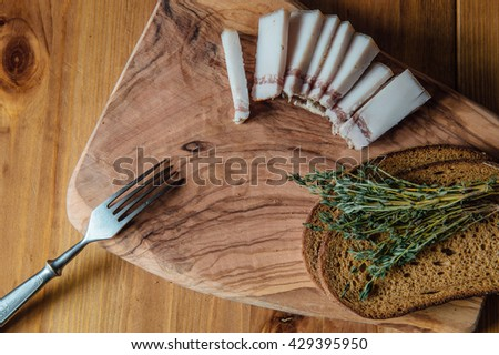 Still  with bacon, bread and Thymus  - stock photo