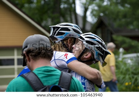 STILLWATER, MINNESOTA - JUNE 17: Teammate Sean Sullivan congratulates pro cyclist Christian Helmig following  win at final stage of Nature Valley Grand Prix at Criterium on June 17, 2012 in Stillwater - stock photo