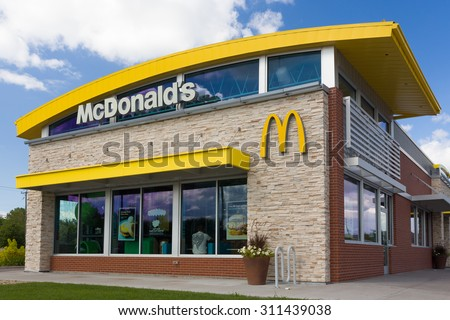 STILLWATER, MN/USA - August 10, 2015: Contemporary McDonald's exterior. The McDonald's Corporation is the world's largest chain of hamburger fast food restaurants. - stock photo
