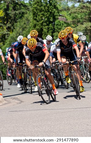 STILLWATER, MN/USA - JUNE 21, 2015: Team Optum leads chase at Stillwater Criterium or stage six of prestigious 2015 North Star Grand Prix pro cycling event in Stillwater. - stock photo