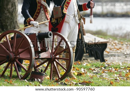 STILLWATER,NY, USA - NOV 6: Colonial soldiers prepare to fire a canon at British Soldiers at the annual Battle of Saratoga Reenactment on November 6, 2010 in Stillwater, NY, USA - stock photo