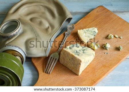 Stinky cheese and gas mask funny abstract of food concept