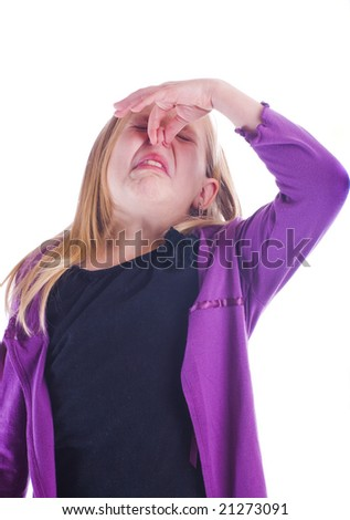 stinky smell with girl holding her nose and frowning - stock photo