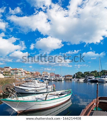 Stintino small port under a cloudy sky - stock photo
