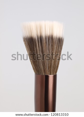 Stippling brush for make-up  isolated on grey - stock photo