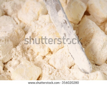 Stir diced butter to coat in flour. Making short-cut puff pastry series.