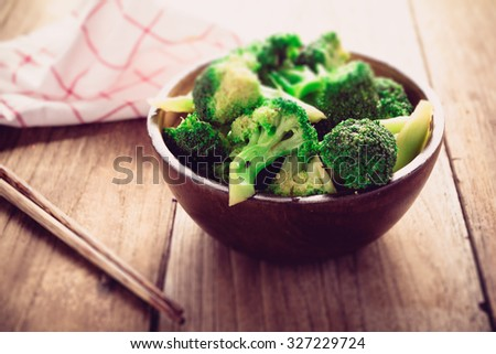 Stir-Fried Broccoli on old wood table, Vegetarian food - stock photo