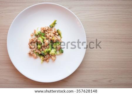 Stir-Fried Broccoli with pork on white dish top view - stock photo