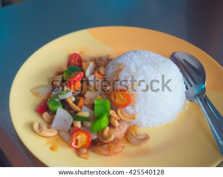 Stir-fried chicken plus cashew nut and herb with rice - stock photo