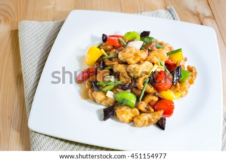 Stir fried Chicken with cashew nuts in white dish