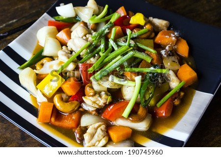Stir-fried Chicken with cashew nuts on table
