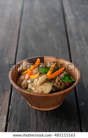 Stir fried chicken with spicy curry paste on wood plate/ Thai food