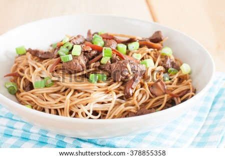 stir-fried chow mein with beef meat - stock photo
