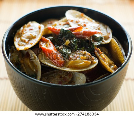 ... CLAMS WITH ROASTED CHILI PASTE AND THAI BASIL LEAVES. - stock photo