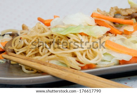 Stir-fried egg noodles with mix vegetables and ground tofu,asian dish.