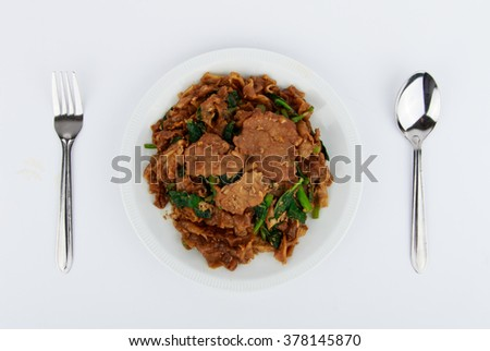 Stir fried flat noodle and pork with dark soy sauce (Thai people called Pad See Ew) - stock photo