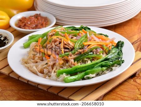 Stir-Fried flat rice noodles,pork,and vegetables  - stock photo