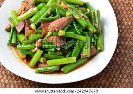Stir-fried green Chinese chives with pork liver isolated. - stock photo