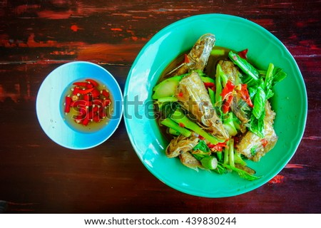 Stir fried kaled with sun dried salted fish - stock photo